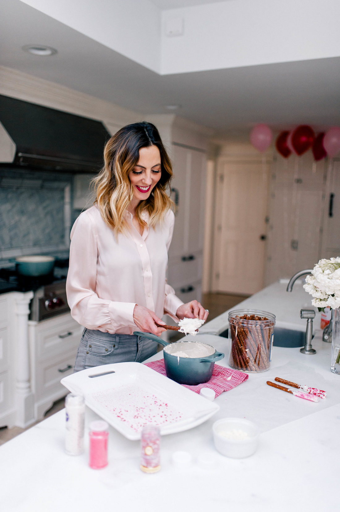 Eva Amurri Martino makes chocolate covered pretzels with valentine's day decorations