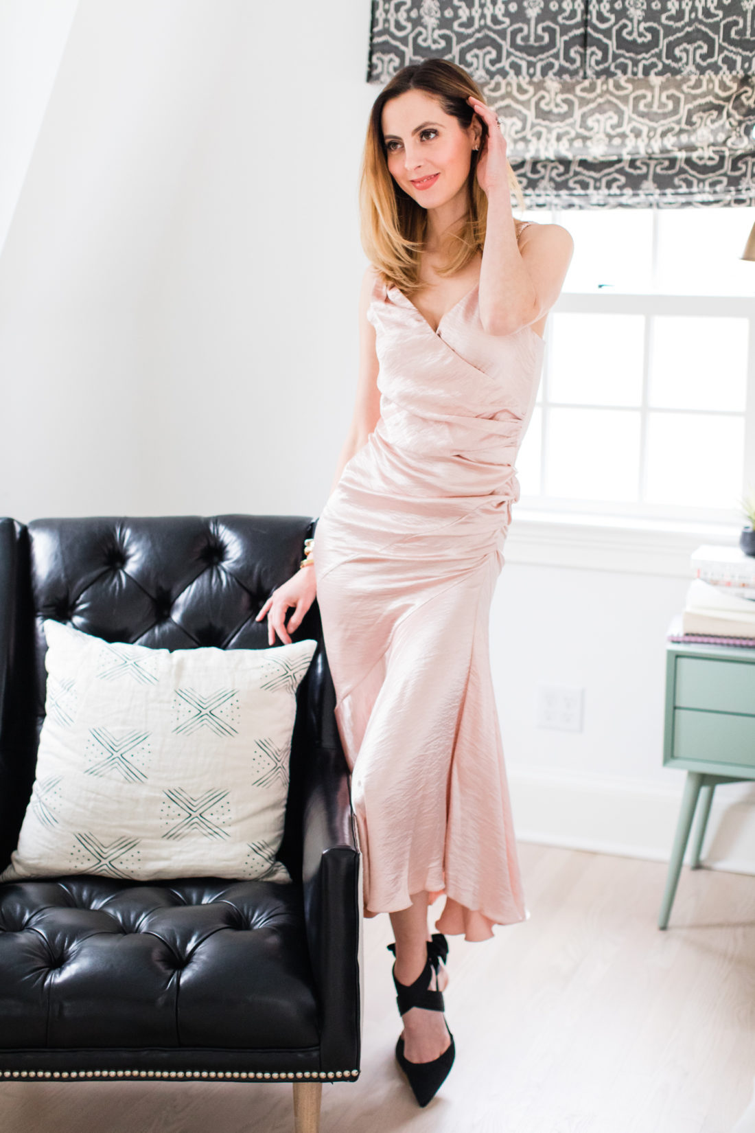 Eva Amurri Martino wears a blush pink silk dress for date night in the master bedroom of her Connecticut home