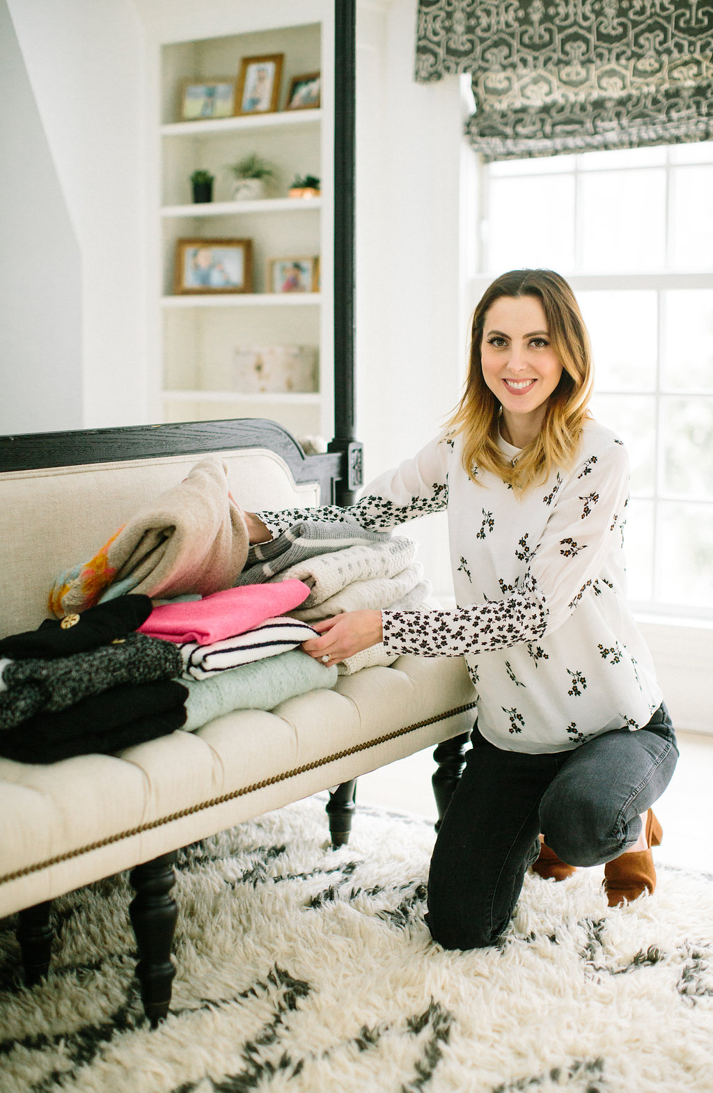 Eva Amurri Martino organizes her sweaters as part of her closet cleanout