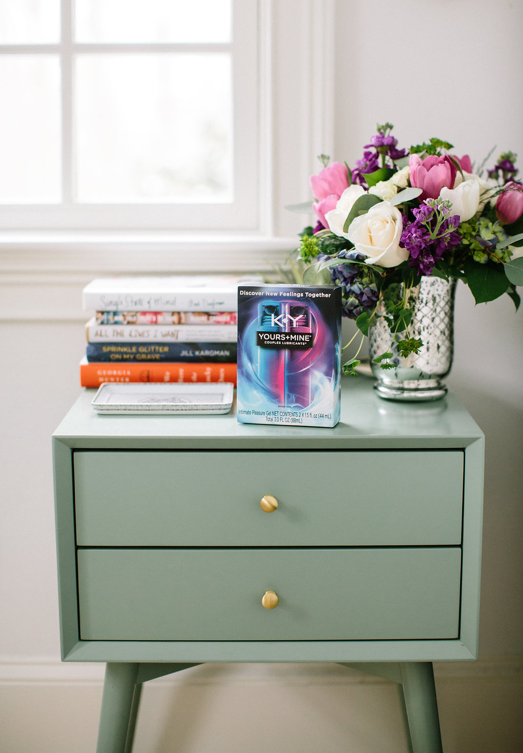 A box of K-Y lubricant sits on the bedside table along with a bouquet of flowers and a stack of books in the Master Bedroom of Eva Amurri Martino's Connecticut home