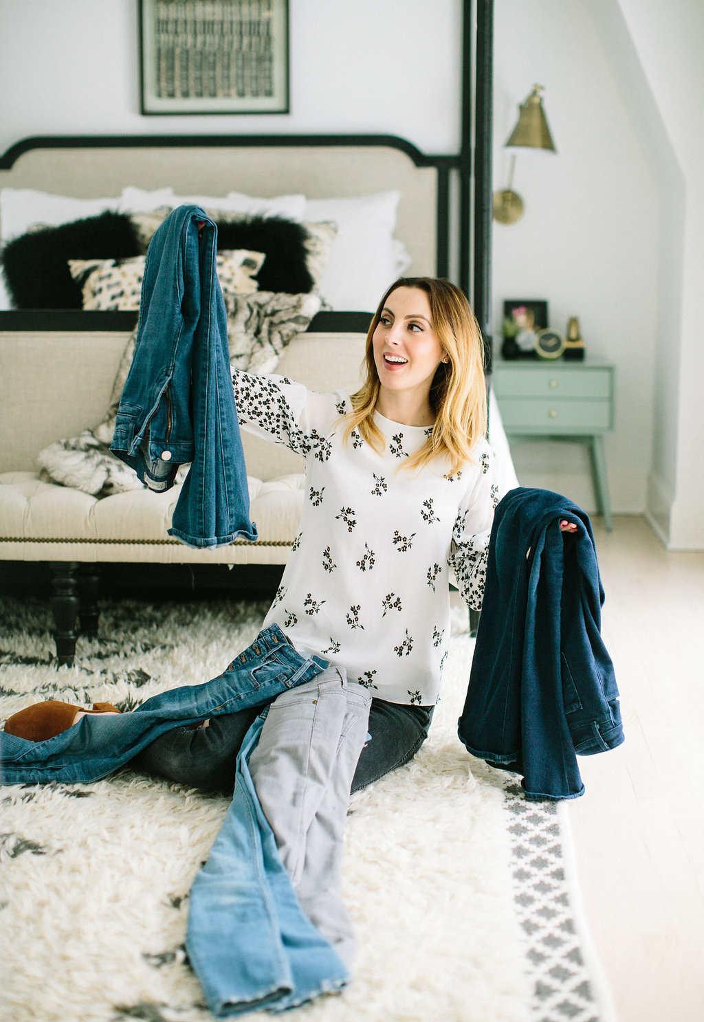 Eva Amurri Martino sits with a pile of jeans on her lap as she cleans out her closet
