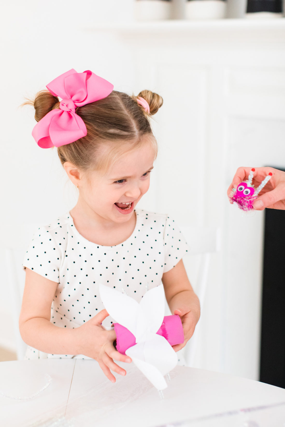 Marlowe Martino has fun crafting DIY Lovebugs for Valentine's Day at her kitchen table