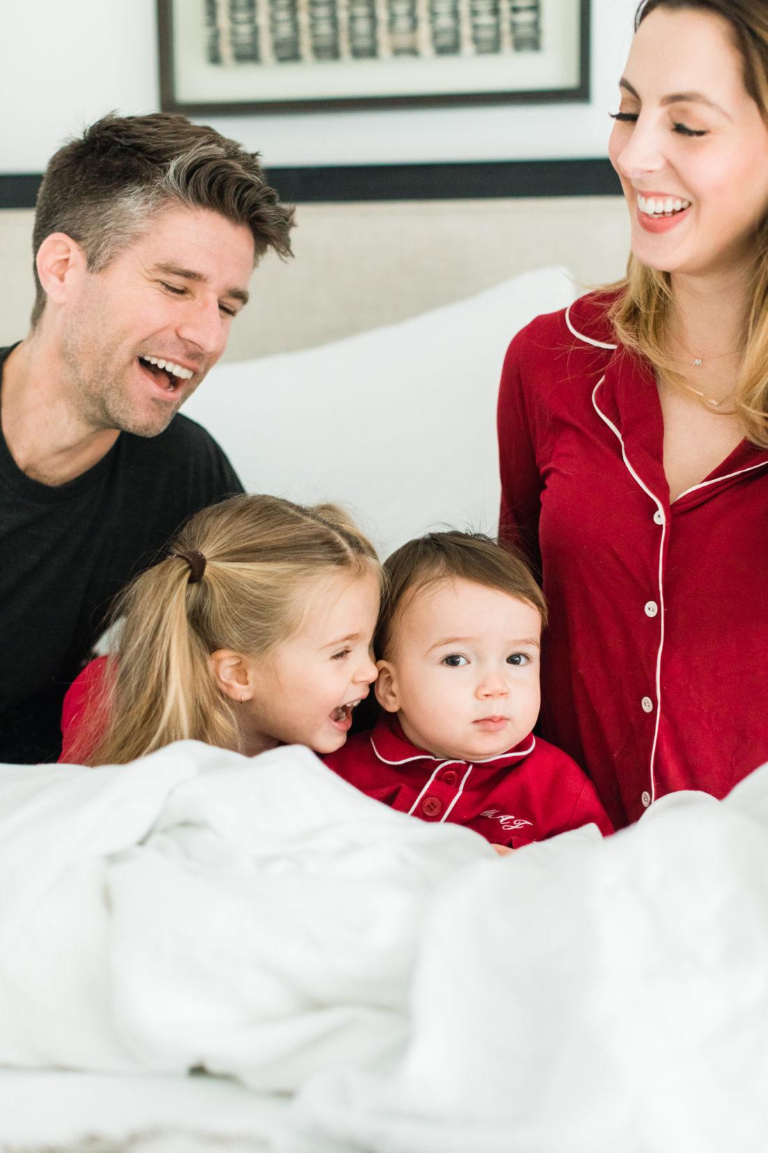 Marlowe Martino snuggles up with brother Major Martino wearing matching red pajamas