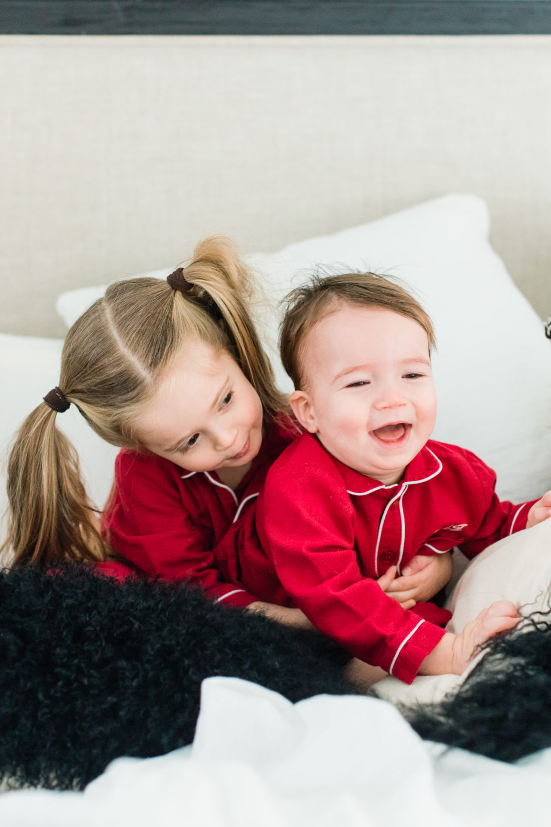 Marlowe Martino laughs and wrestles with little brother Major in the master bedroom of their Connecticut home