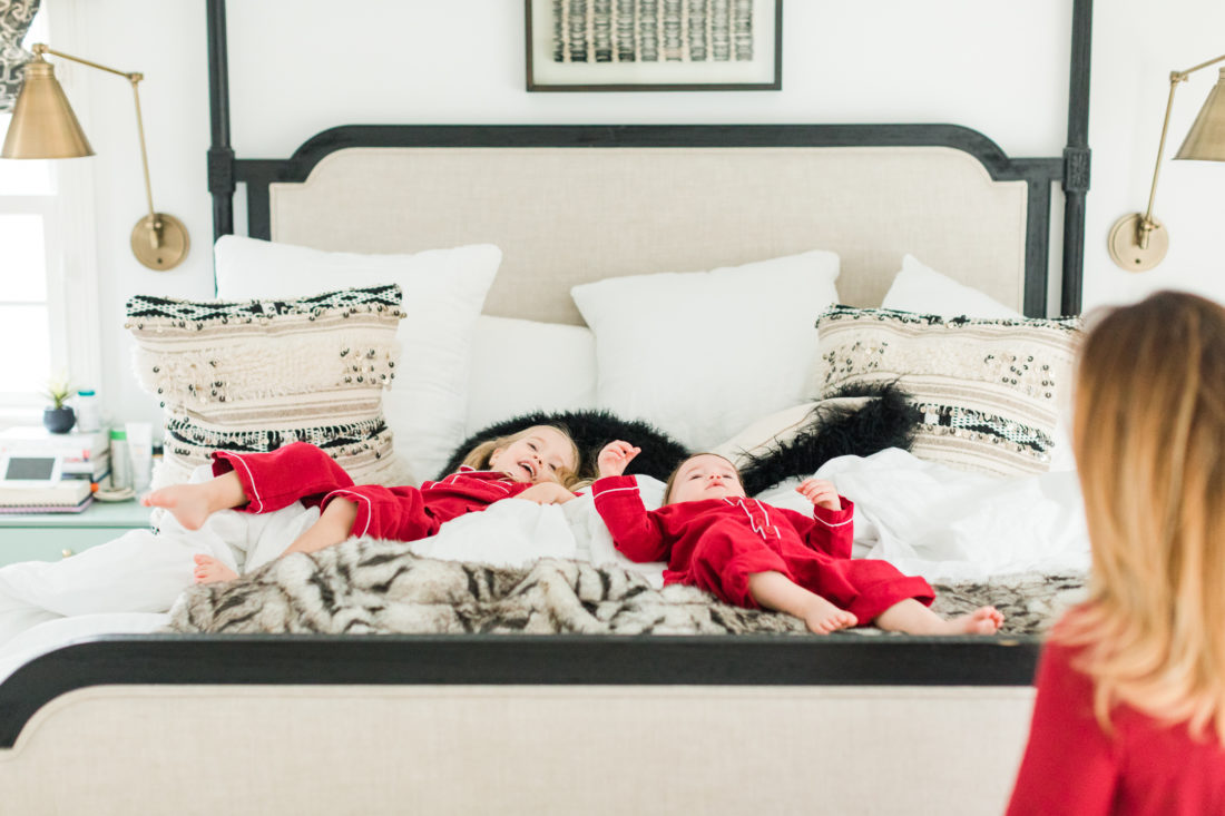 Marlowe and Major fall back in to the Master bed at home in Connecticut wearing matching red pajamas for Valentine's Day