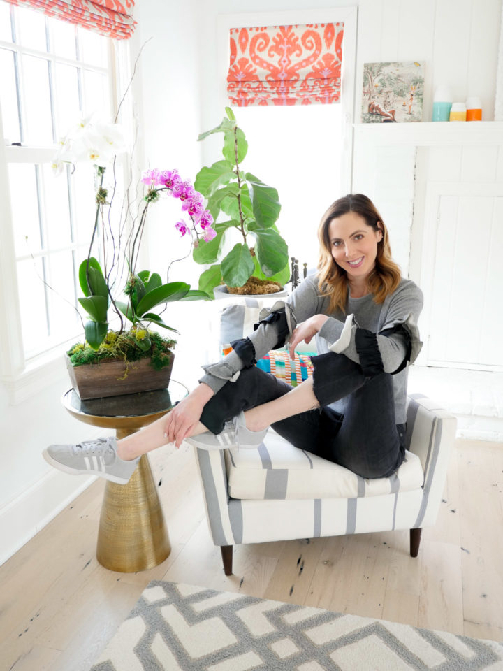 Eva Amurri Martino shows off her favorite spring sneakers on a chair in her house in Connecticut