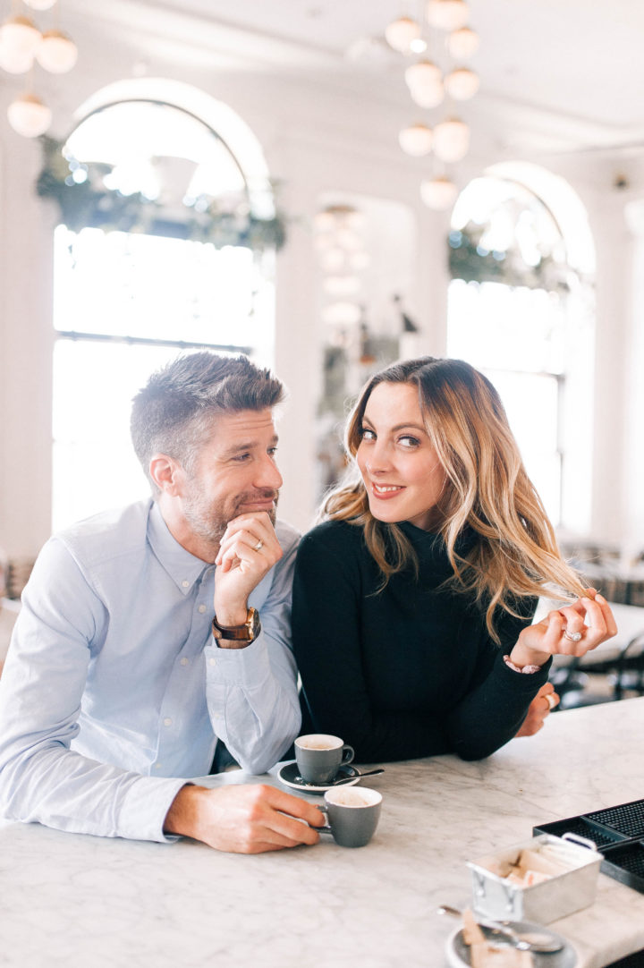 Kyle Martino stares lovingly into his wife Eva Amurri Martino while she plays with her hair at a restaurant