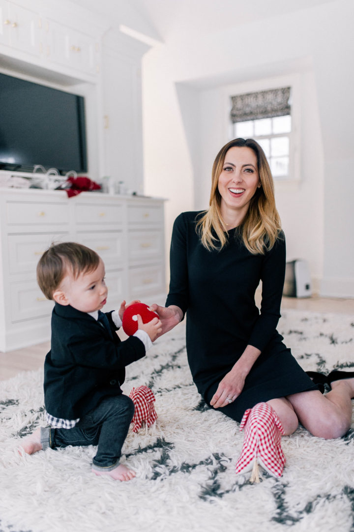 Eva Amurri Martino plays on the floor of her bedroom with her son Major James in a black dress.