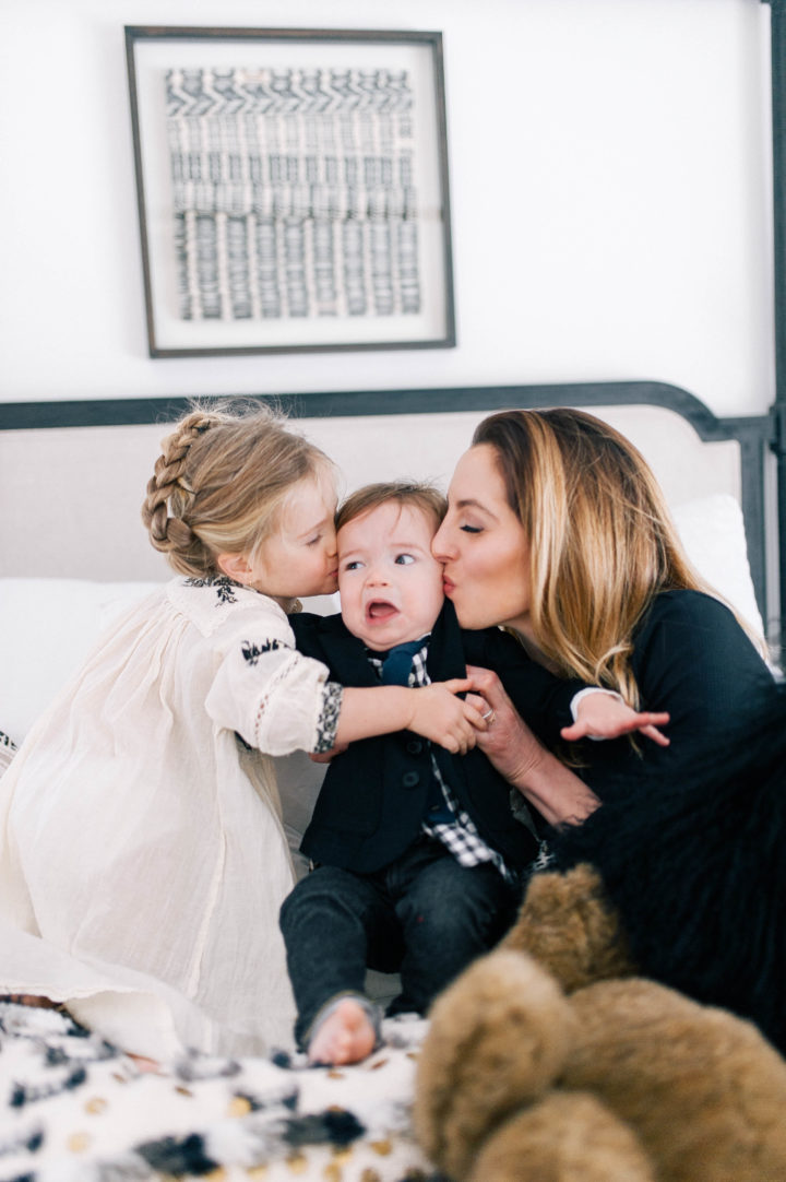 Eva Amurri Martino and her daughter Marlowe Mae Martino kissing son Major James Martino on the bed in their Connecticut home.