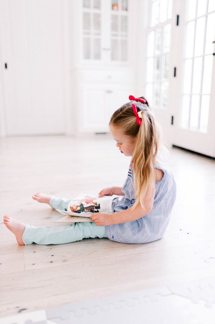 Eva Amurri Martino's daughter Marlowe reads a book on the kitchen floor of her Connecticut home.