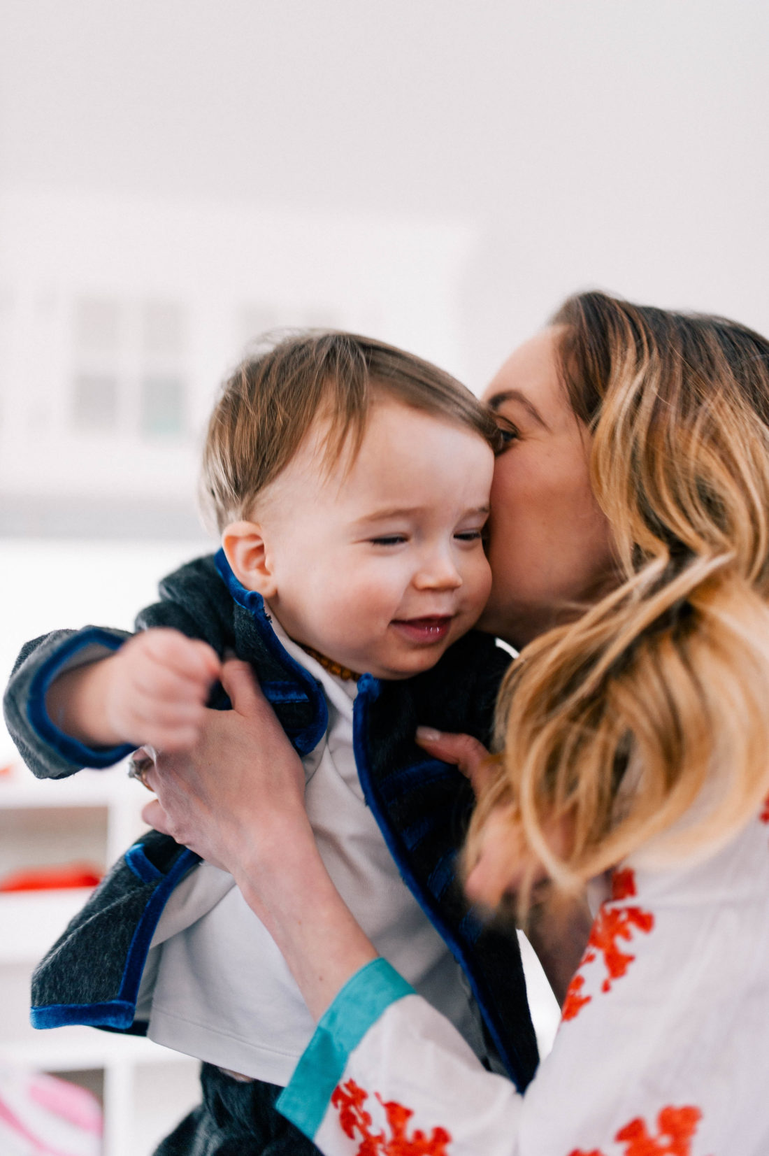 Eva Amurri Martino kisses and snuggles one year old son Major James in the family room of their Connecticut home