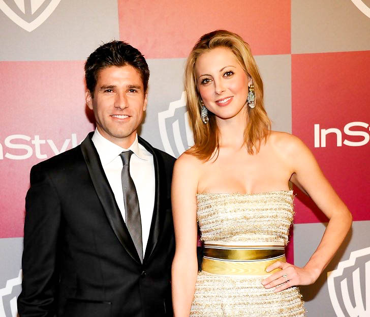 Eva Amurri Martino and Kyle Martino pose on the red carpet at the InStyle Golden Globes bash