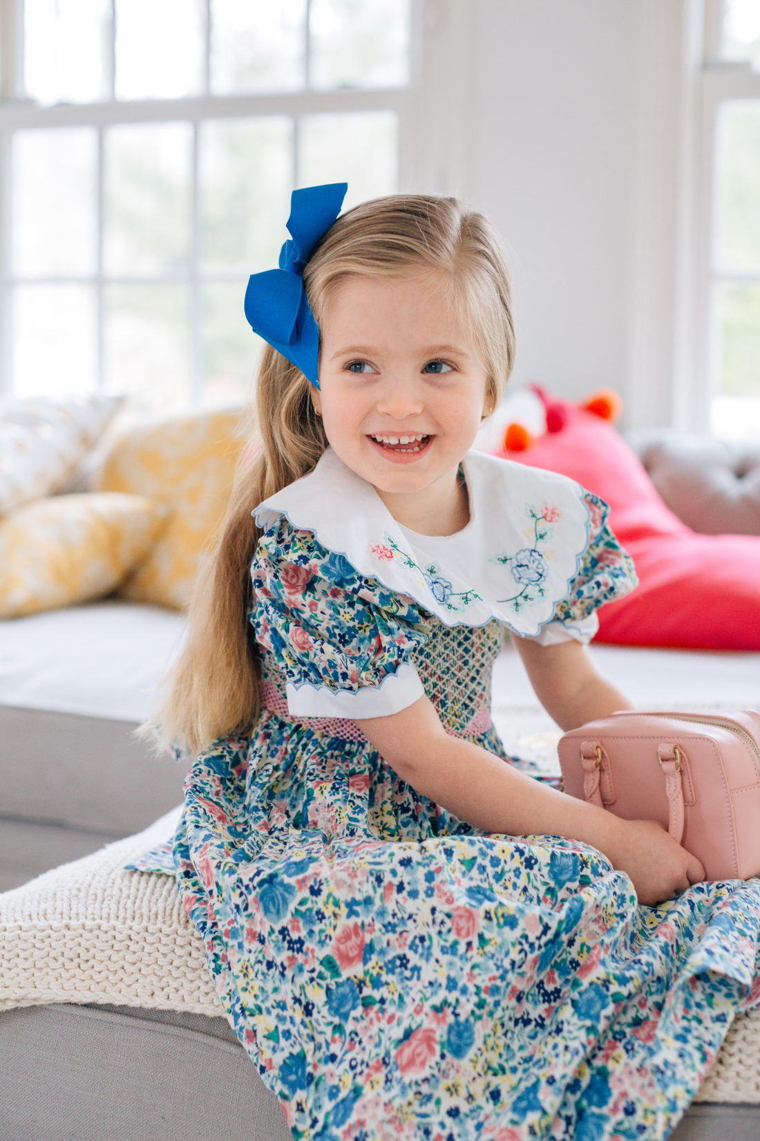 Marlowe Martino wears a vintage floral smocked dress for Easter with an embroidered collar that belonged to mother Eva Amurri Martino