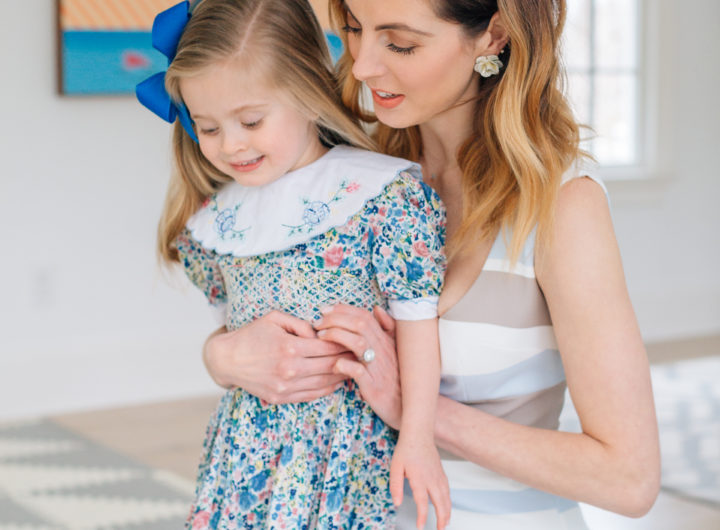 Eva Amurri Martino holds three year old daughter Marlowe Martino on her lap wearing a floral dress for Easter