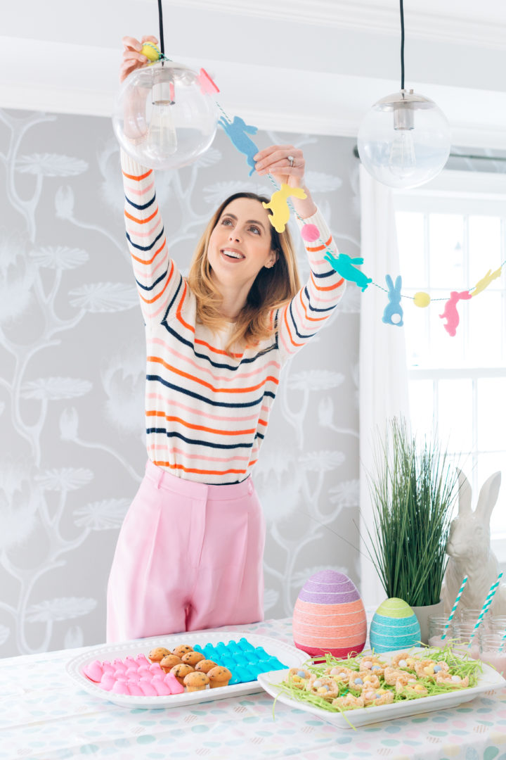 Eva Amurri Martino puts the finishing touches on the Easter decorations before her annual Easter Egg Hunt