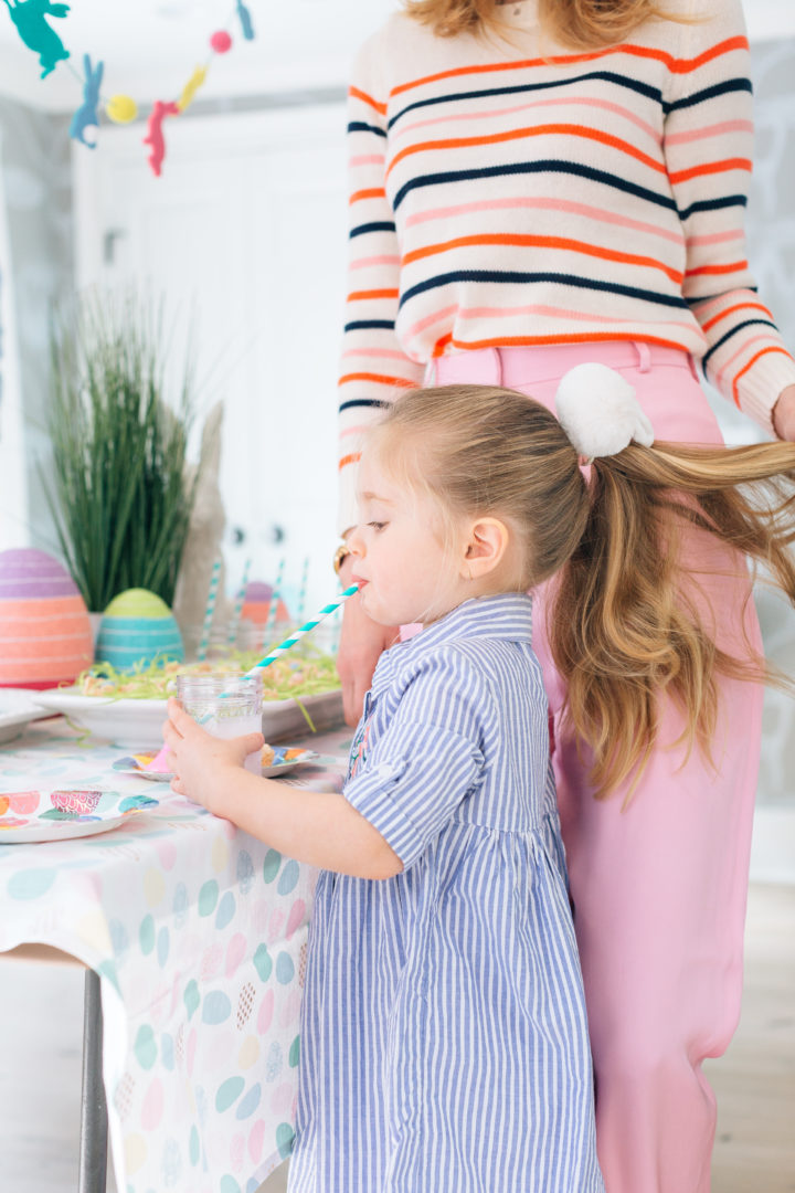 Eva Amurri Martino plays with daughter Marlow's hair while she drinks a pink lemonade at her annual Easter Egg Hunt