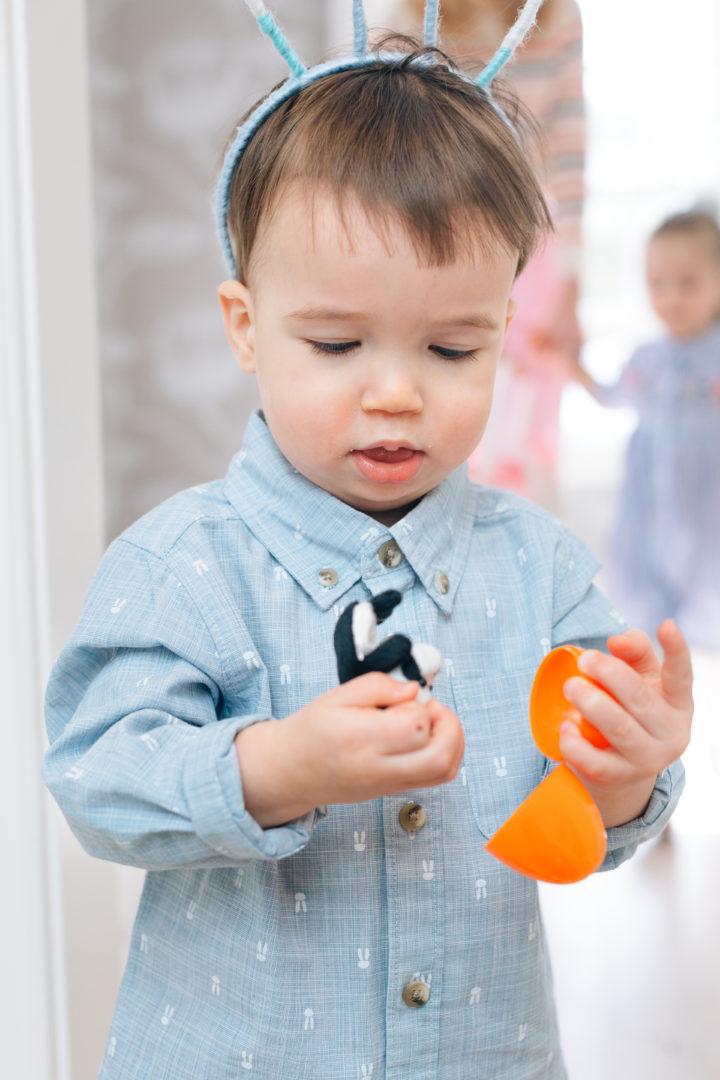 Major Martino opening an orange easter egg