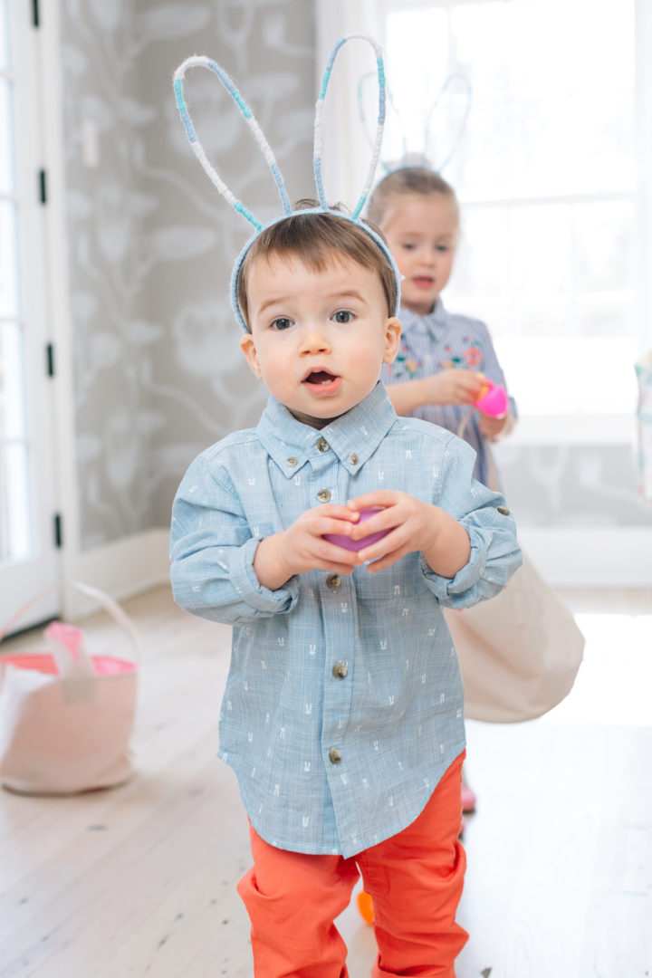 Major Martino finding eggs at his family's Easter Egg Hunt at their home in Connecticut.