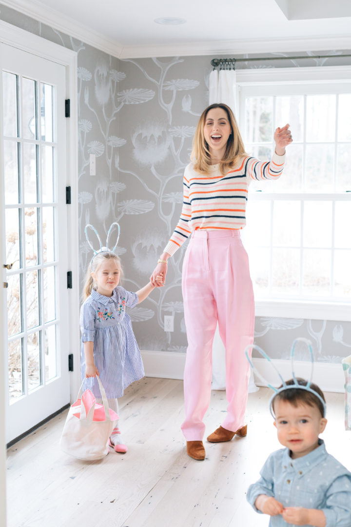 Eva Amurri Martino laughing with her children Marlow and Major who are wearing bunny ears for their annual Easter Egg Hunt