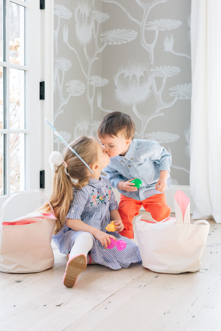 Siblings Marlowe and Major Martino give a sweet kiss to each other at their family's The Easter decorations at Eva Amurri Martino's annual Easter Egg Hunt at her home in Connecticut