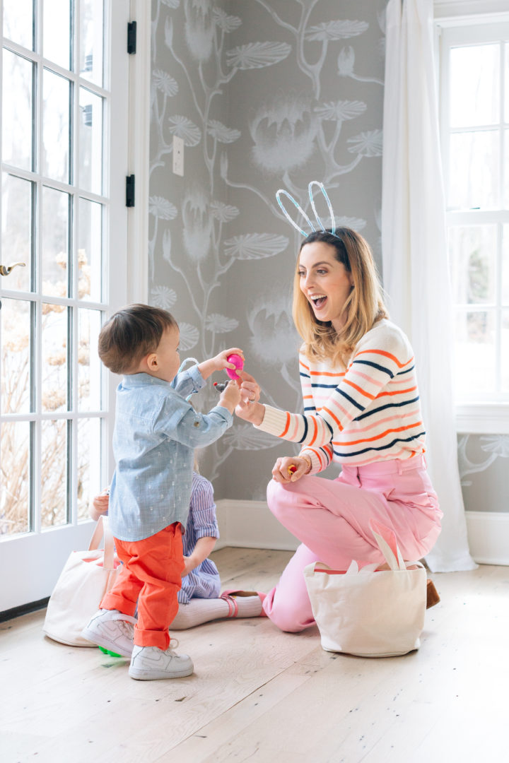 Eva Amurri Martino giving a plastic egg during her annual Easter Egg Hunt with her son Major