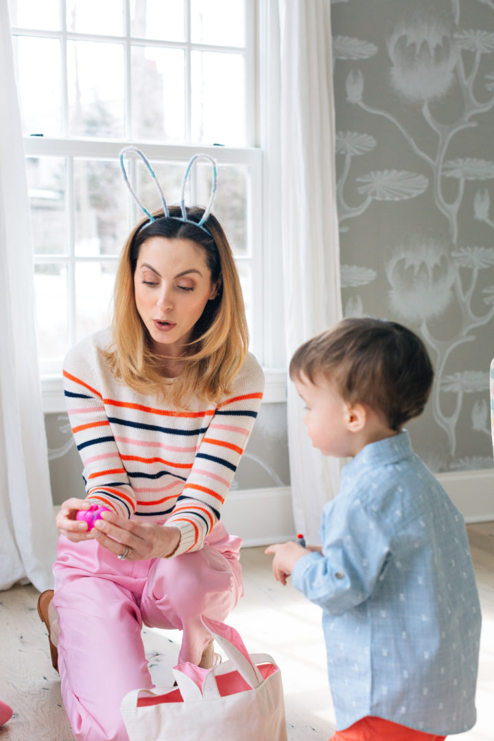 Eva Amurri Martino finding a finger puppet toy inside of a plastic egg during her annual Easter Egg Hunt with her children Marlow and Major