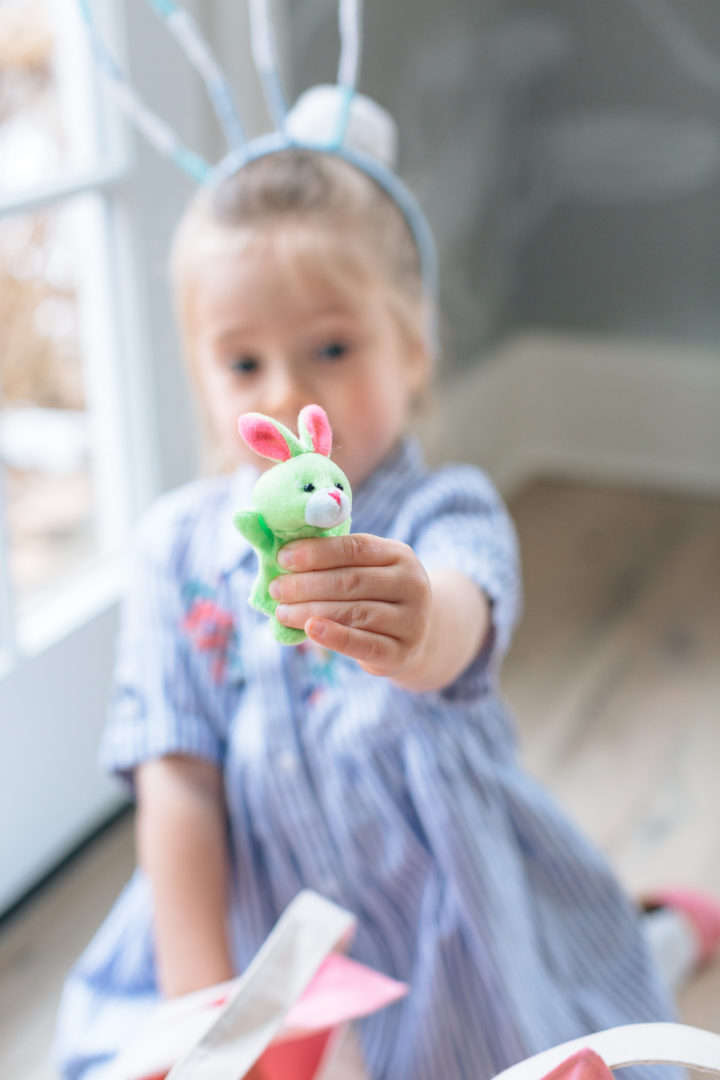 Marlowe Martino finds a toy inside of an easter egg at her family's annual Easter Egg Hunt at their home in Connecticut