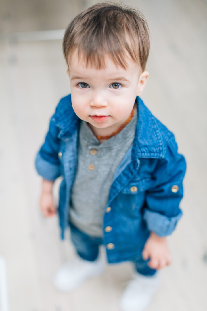Stylish tot, Major Martino, wears a trendy denim button up over a grey t-shirt.