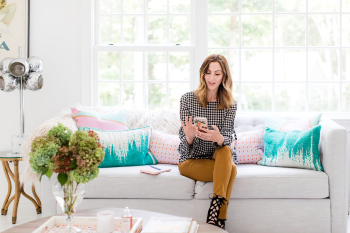 Eva Amurri Martino scrolls through her cell phone while she sits in the Happily Eva After studio in Connecticut