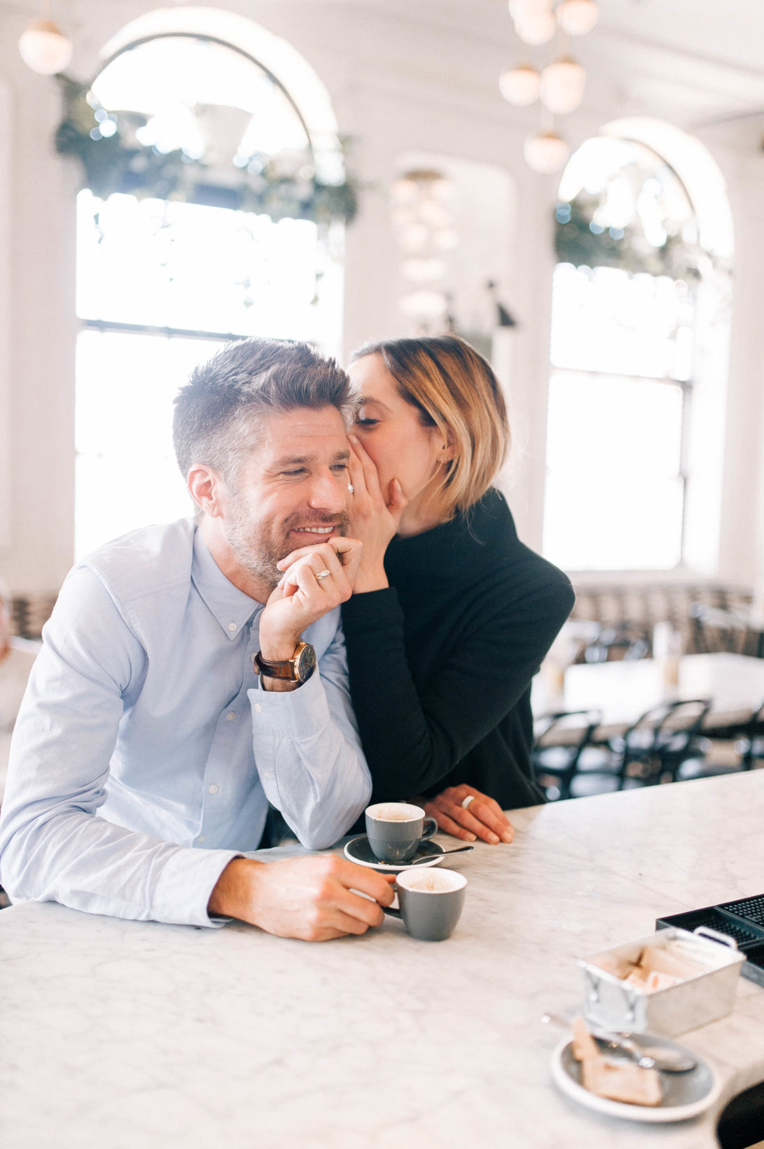 Eva Amurri Martino stands at the bar of an NYC restaurant and whispers in to husband Kyle Martino's ear
