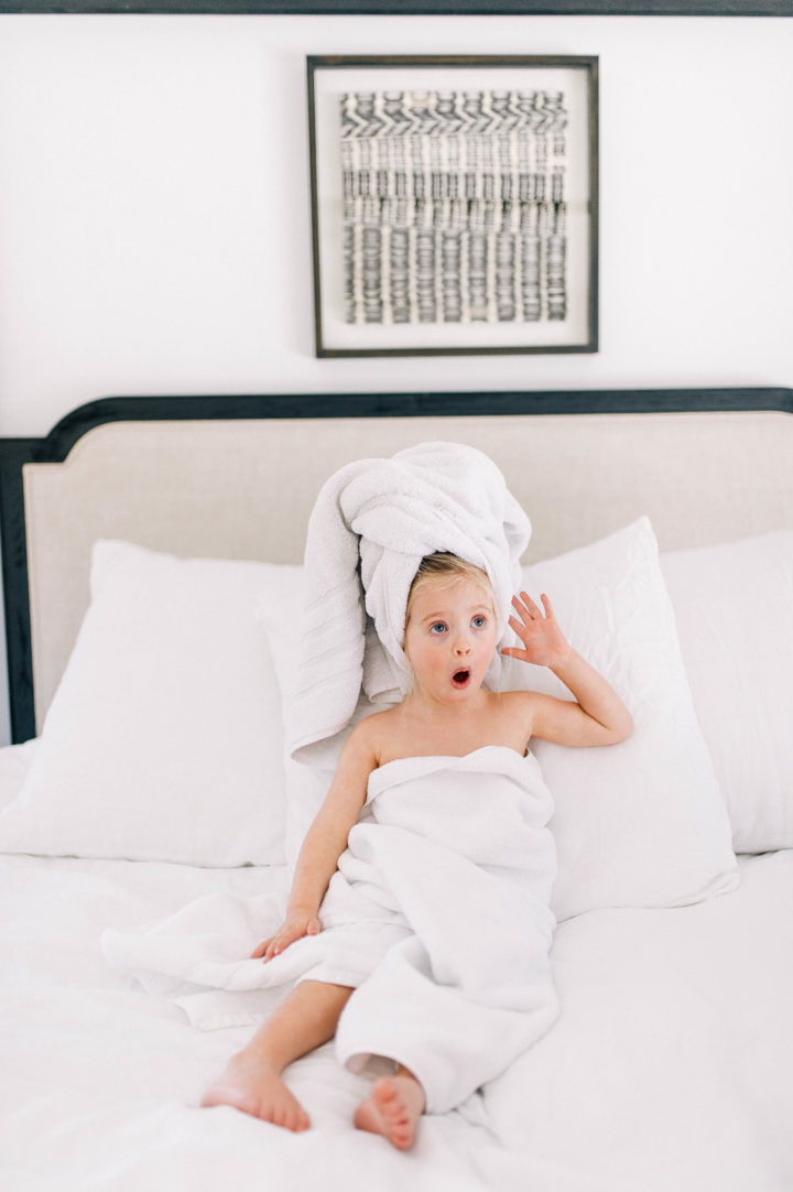 Eva Amurri Martino's daughter Marlowe makes a silly face while she lies in bed with a towel in her hair