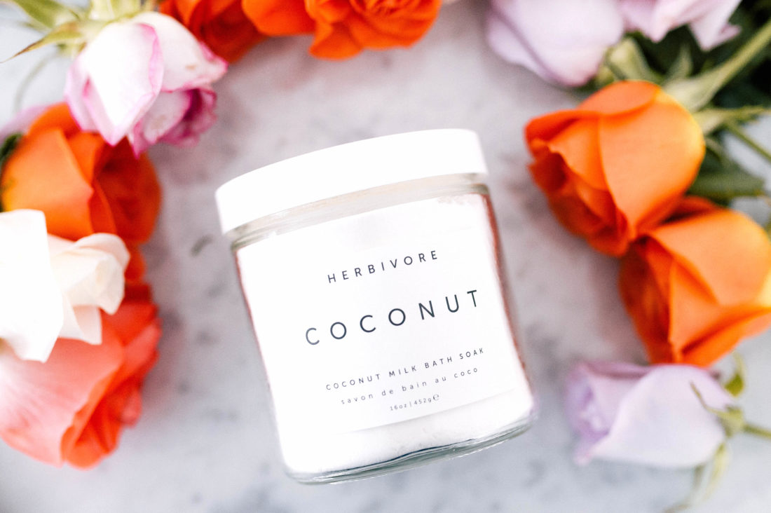 Herbivore Coconut Bath Soak surrounded by flowers as part of Eva Amurri Martino's monthly obsessions roundup