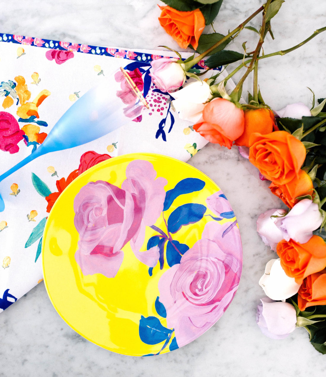 Eva Amurri Martino shares some brightly colored flowered melamine plates as part of her monthly obsessions product roundup