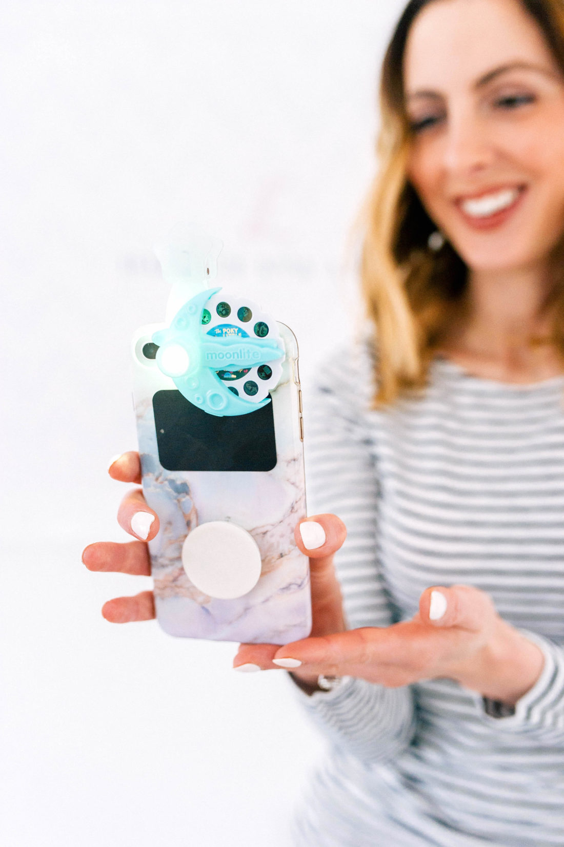 Eva Amurri Martino fits the Moonlite storybook projectoron her phone
