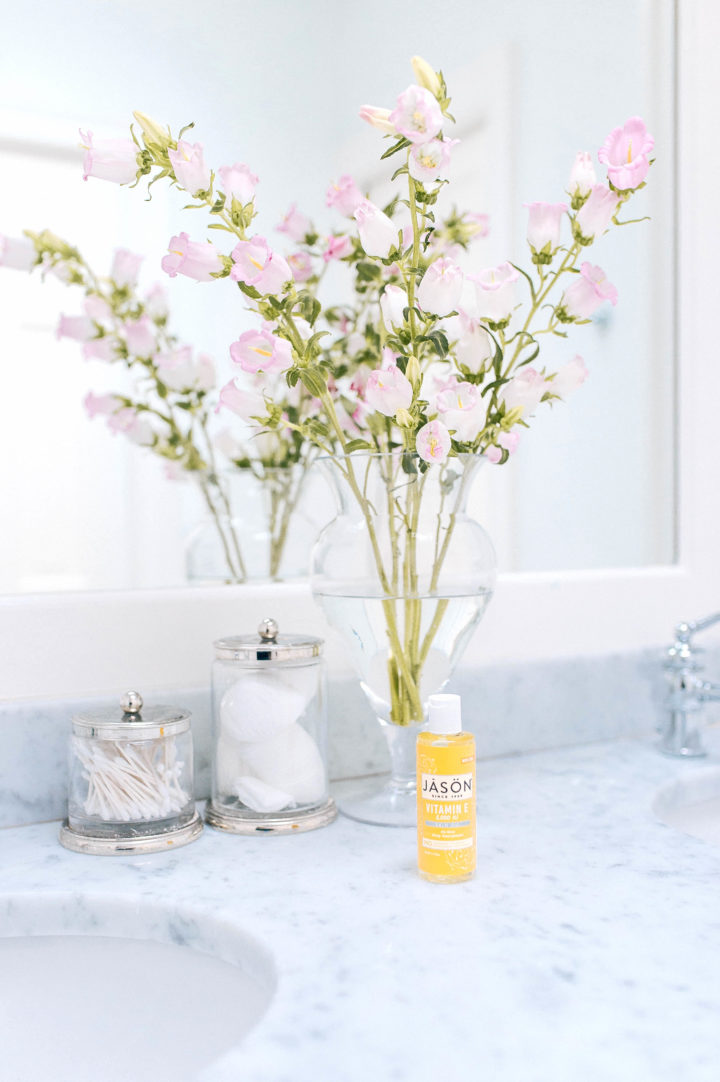 Jason Vitamin E Oil Lotion in Eva Amurri Martino's white marble bathroom in Connecticut