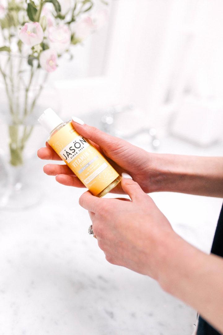 Eva Amurri Martino holds Jason Vitamin E Oil lotion in her hands