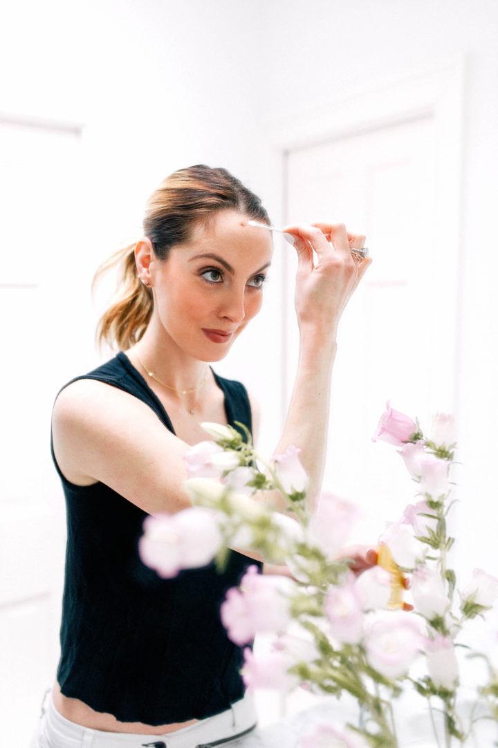 Eva Amurri Martino rubs Jason Vitamin E Oil lotion onto her forehead