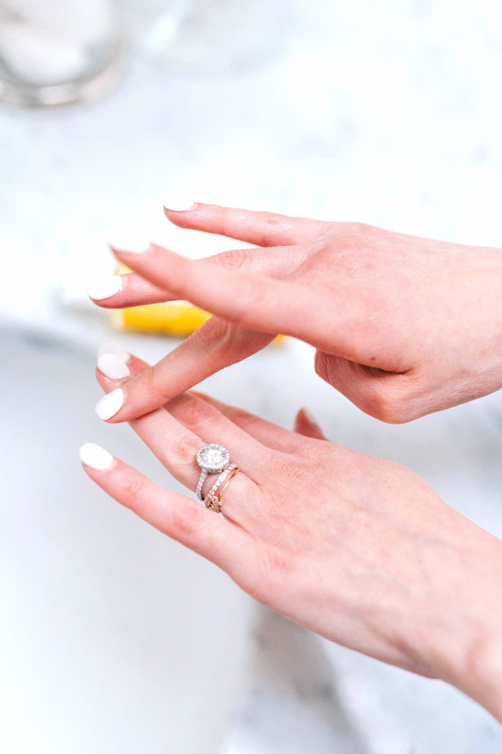 Eva Amurri Martino rubs Jason Vitamin E Oil lotion into her fingers