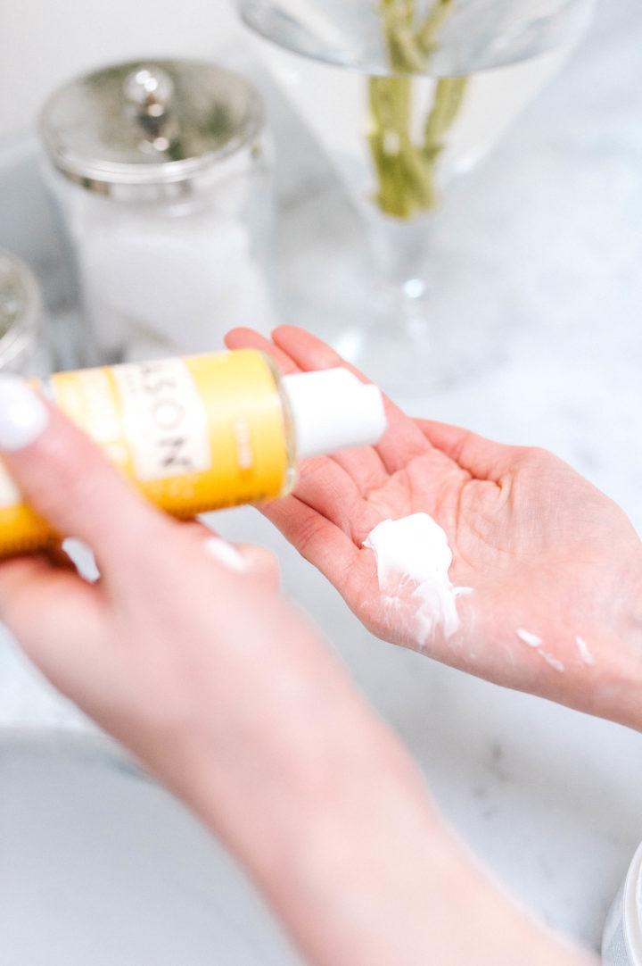 Eva Amurri Martino rubs Jason Vitamin E Oil lotion into her hand