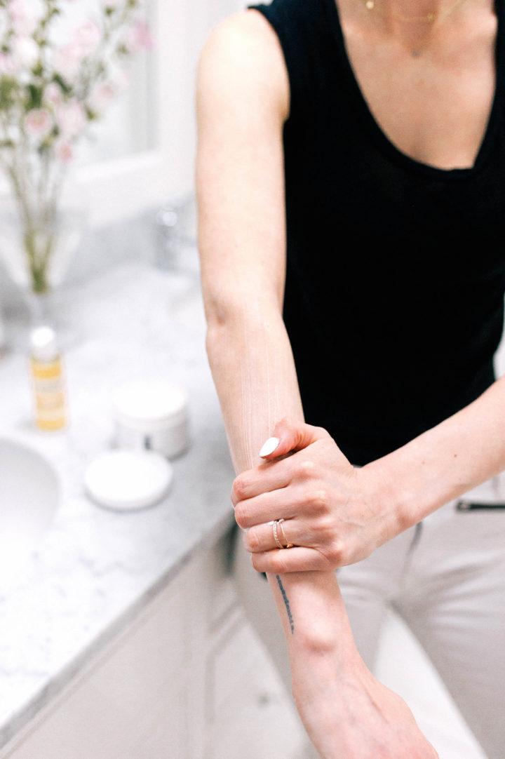 Eva Amurri Martino rubs Jason Vitamin E Oil lotion onto her arms