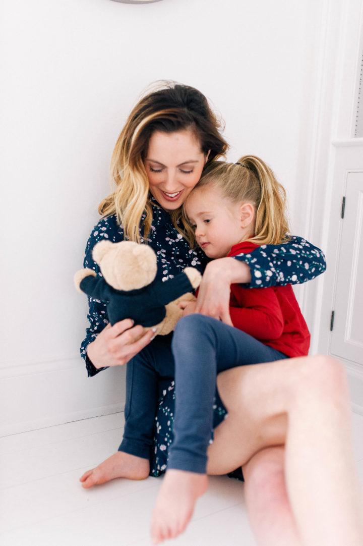 Eva Amurri Martino cradles her daughter Marlowe while holding a teddy bear