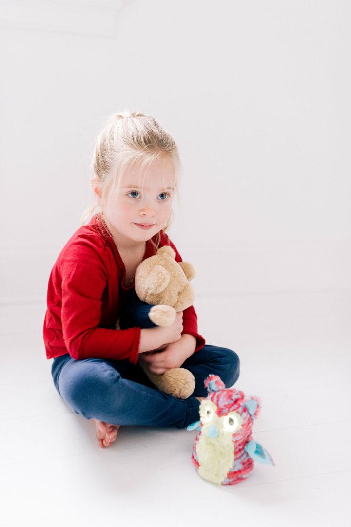 Marlowe Martino cradling a teddy bear