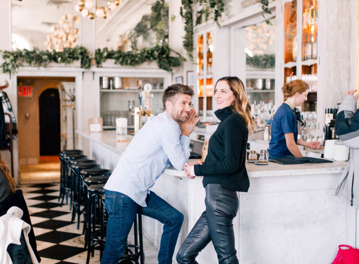 Eva Amurri Martino stands with husband Kyle Martino on the black and white tiled floor of an NYC eatery