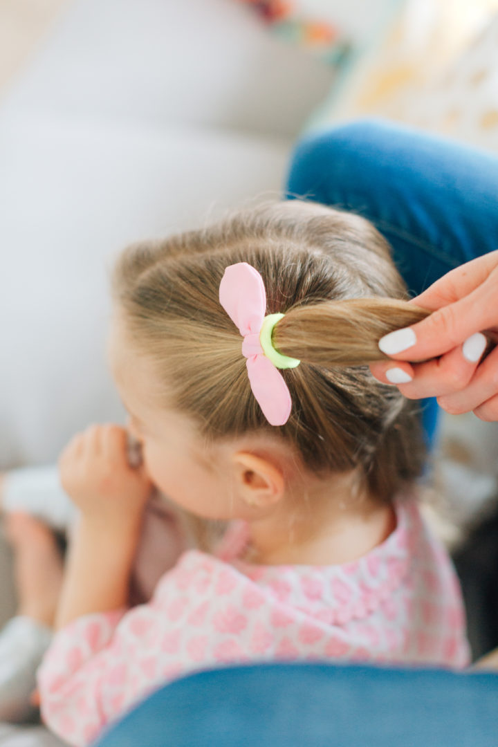 Eva Amurri Martino put her daughter Marlowe's hair into Pigtail Braids secured with pink bow hair ties.