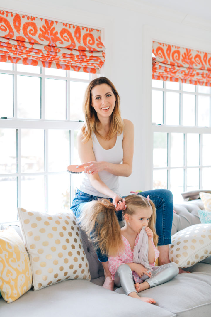 Eva Amurri Martino styles her daughter Marlowe's hair on the couch in her Connecticut home