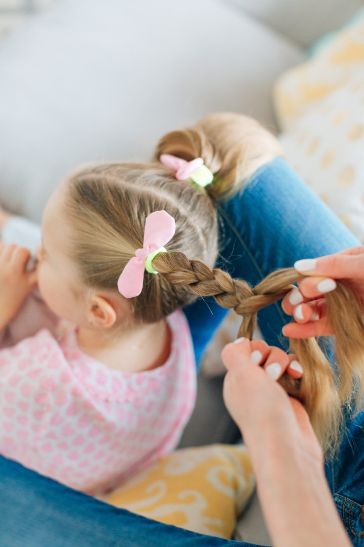 Eva Amurri Martino puts her daughter Marlowe's hair into two Pigtail Braids secured with pink bows.