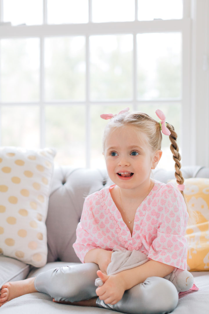 Marlowe Martino shows off her double braided hairstyle on the couch in her Connecticut home.