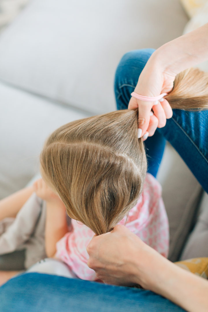 Eva Amurri Martino puts her daughter Marlowe's hair into two twisted knots.
