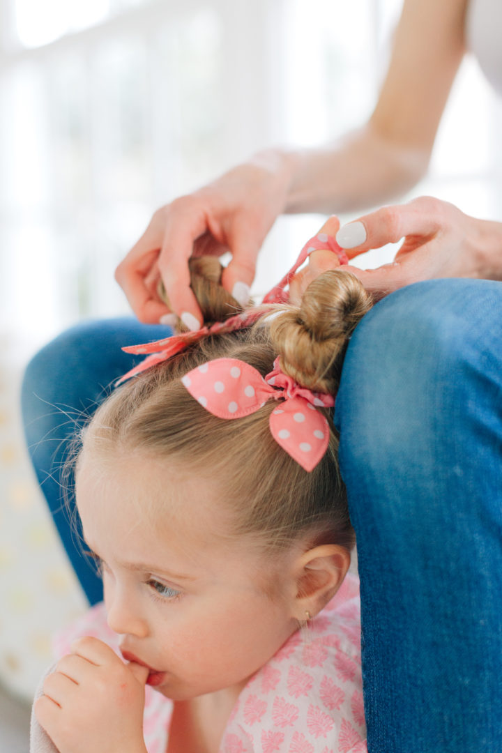 Eva Amurri Martino puts her daughter Marlowe's hair into two twisted knots secured with pink polka dot hairties.