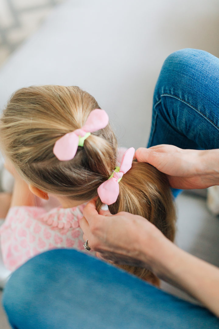 Marlowe Martino shows off her Two Bunch Ponytail secured with pink bows.